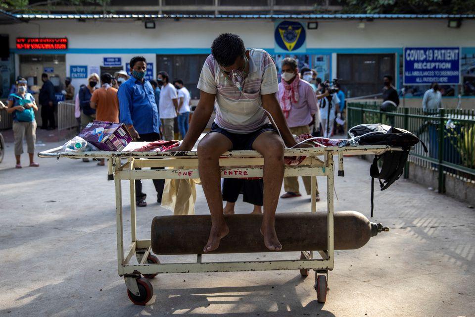 India's daily coronavirus cases climb to new world record as hospitals buckle