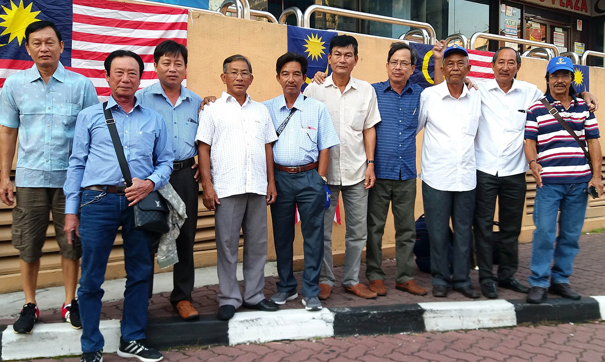 Dr. Bui Thanh Liem (fourth right) and Vietnamese farmers on a trip to Malaysia in a provided photo.