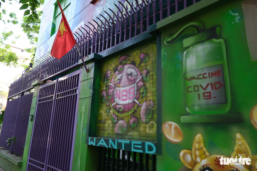 Artist paints murals on house to raise awareness of COVID-19 prevention in Hanoi