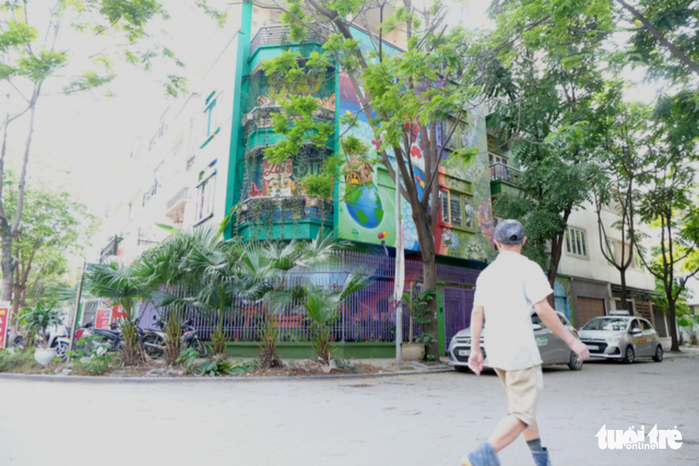 Colorful coronavirus-inspired murals are displayed on the walls of a house at the Van Phu residential quarter in Ha Dong District, Hanoi. Photo: Ha Thanh