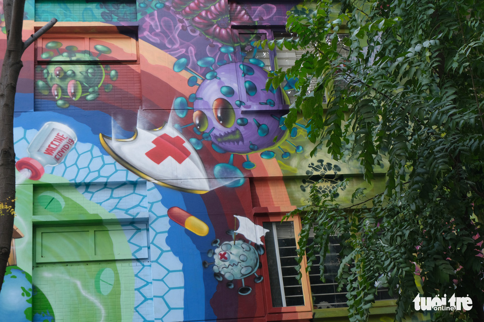 A colorful coronavirus-inspired mural is displayed on the wall of a house at the Van Phu residential quarter in Ha Dong District, Hanoi. Photo: Ha Thanh