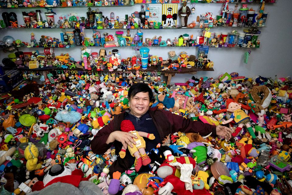 Percival Lugue, who has the Guinness world record for the largest fast-food toy collection, poses with his toy collection in his home in Apalit, Pampanga province, Philippines, April 20, 2021. Photo: Reuters