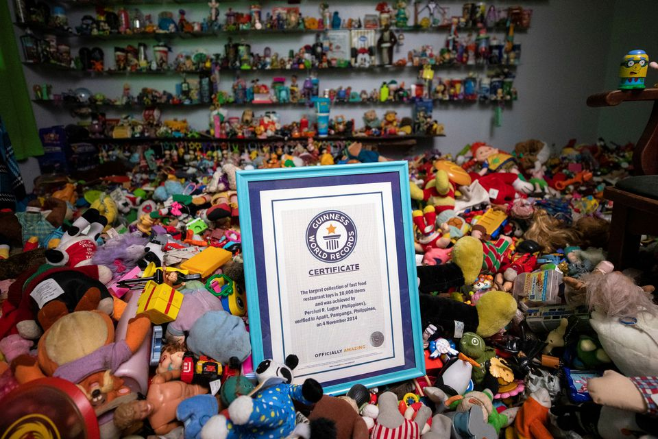 Percival Lugue's certificate for the Guinness world record for the largest fast-food toy collection is photographed with his toy collection in his home in Apalit, Pampanga province, Philippines, April 20, 2021. Photo: Reuters