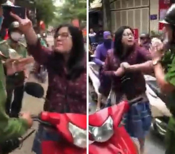 In Vietnam, female traffic rule violator insults and hits police officers for booking her