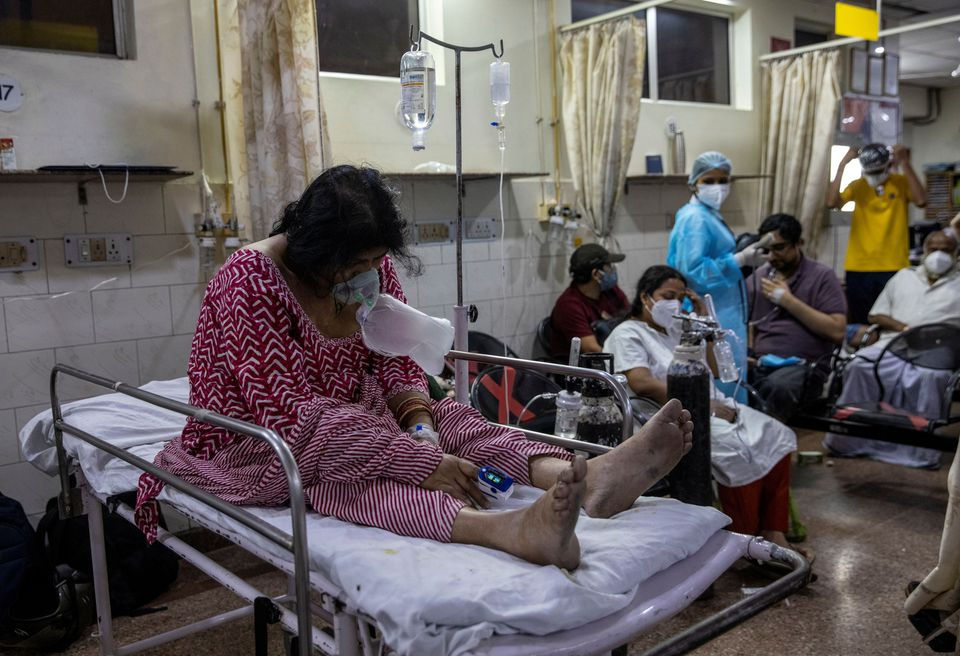 India's COVID-19 daily cases hold close to record, another state imposes lockdown