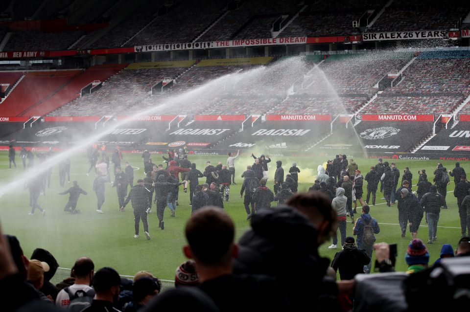 Man United-Liverpool match postponed after fans storm pitch