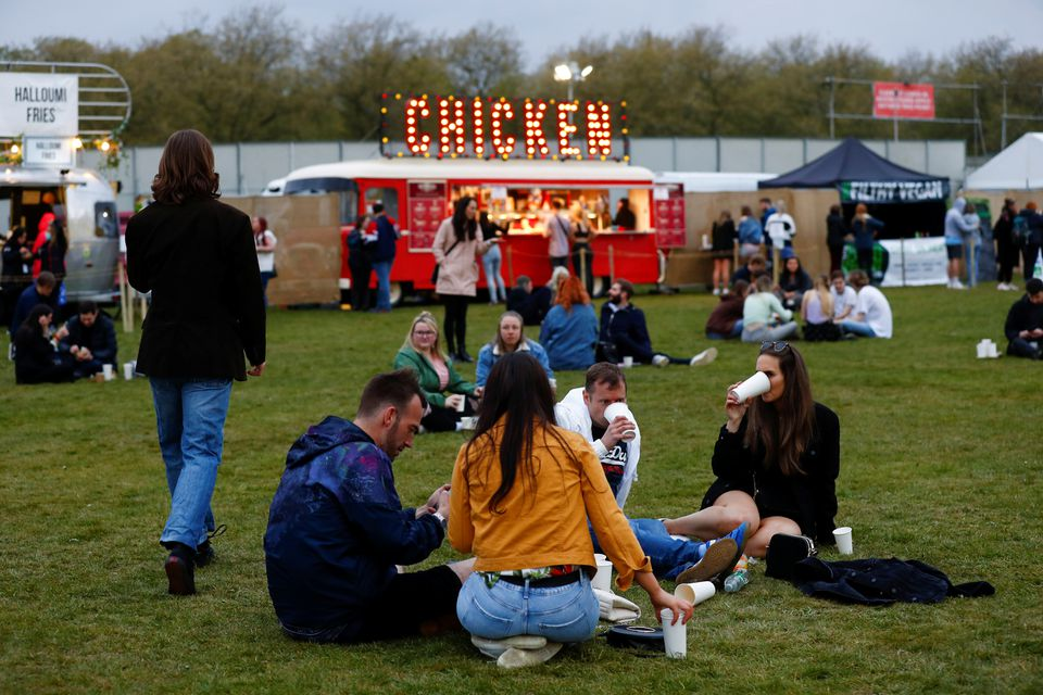 People enjoy their time during a test music festival as part of a national research program assessing the risk of COVID-19 transmission in Liverpool, Britain May 2, 2021. Photo: Reuters