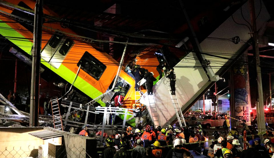Rescuers work at a site where an overpass for a metro partially collapsed with train cars on it at Olivos station in Mexico City, Mexico May 3, 2021. Photo: Reuters