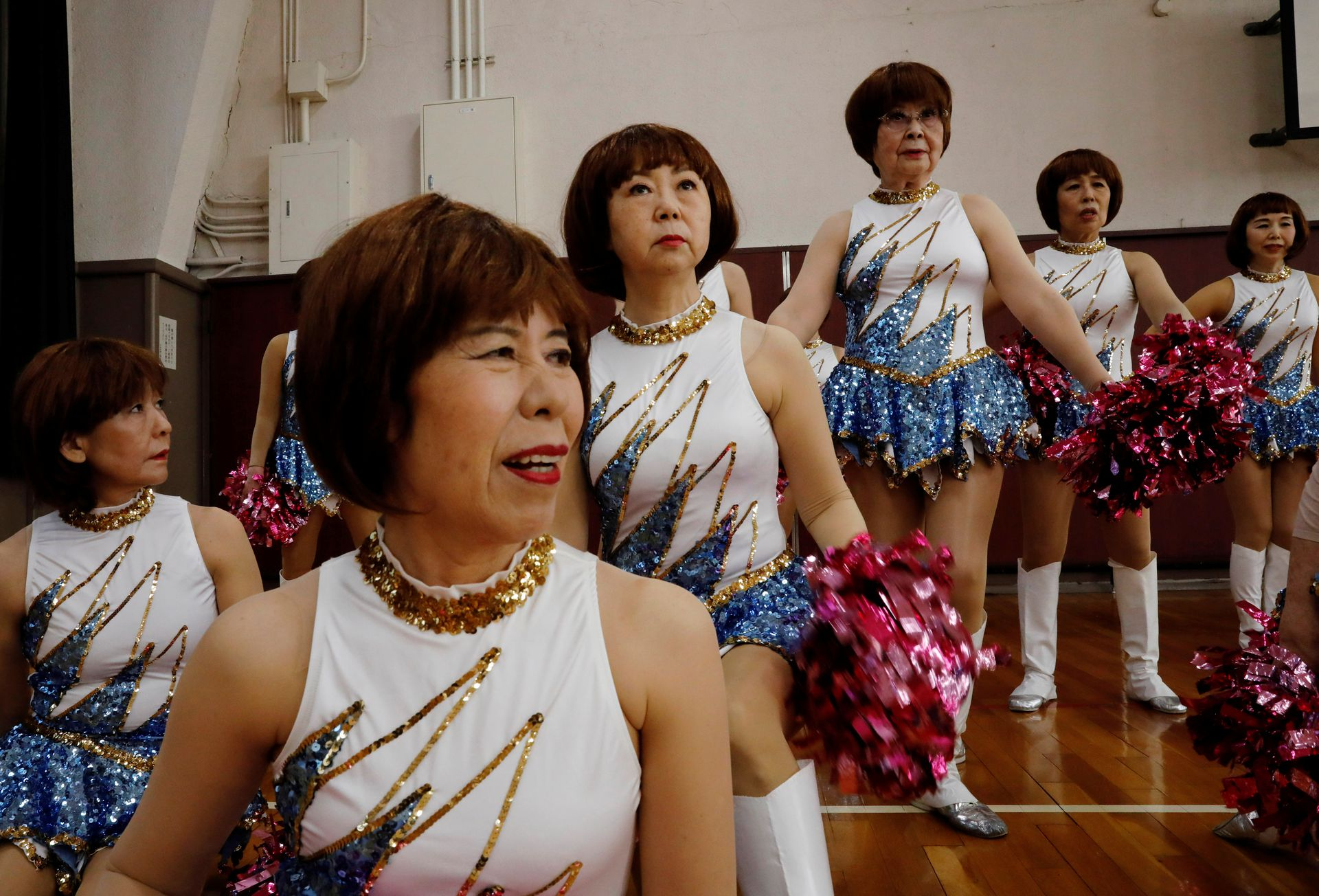 Fumie Takino, 89, founder of a senior cheer squad called Japan Pom Pom, and other members prepare to pose for commemorative photos before filming a dance routine for an online performance in Tokyo, Japan, April 12, 2021. Photo: Reuters