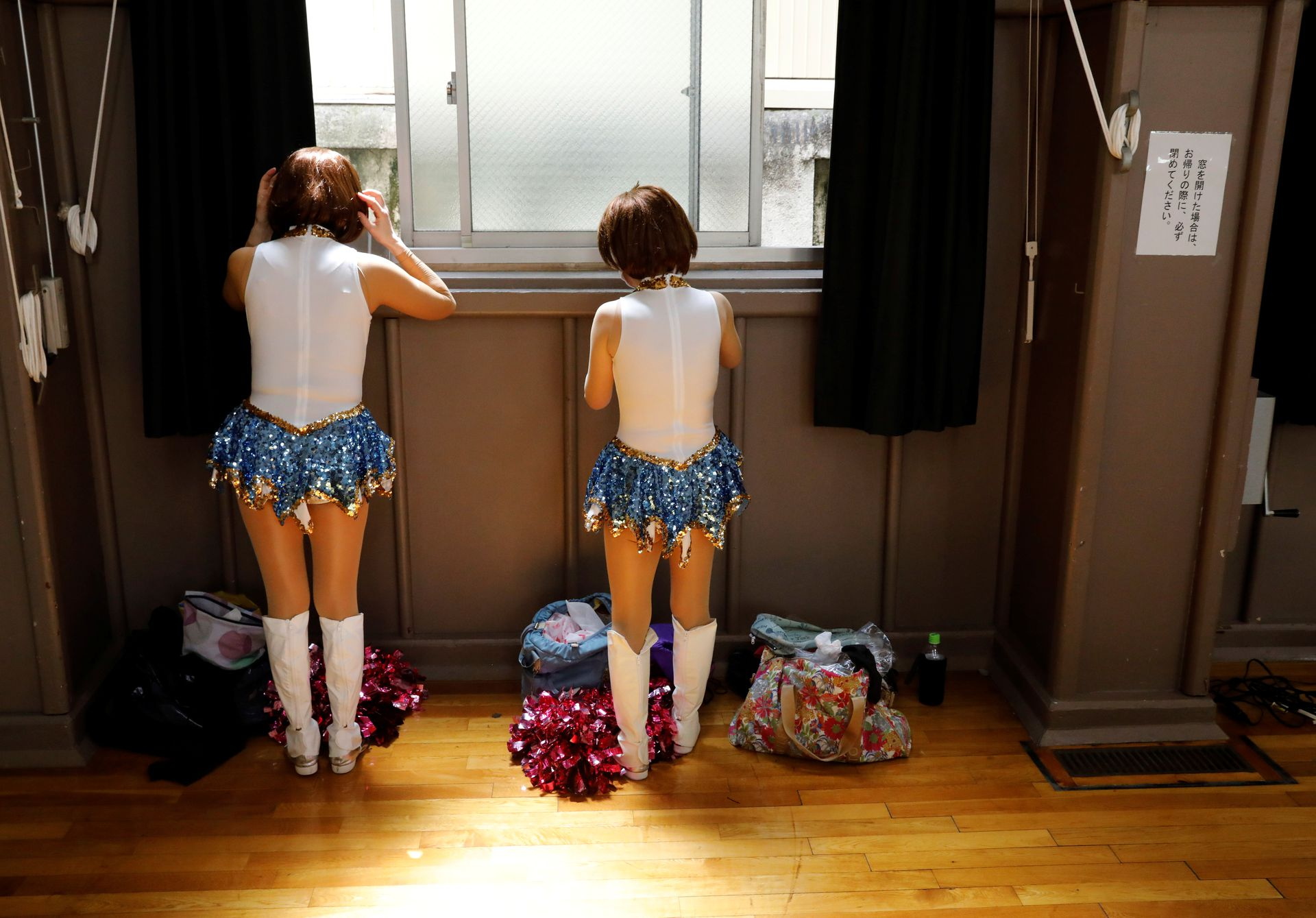 Members of a senior cheer squad called Japan Pom Pom prepare to film a dance routine for an online performance in Tokyo, Japan, April 12, 2021. Photo: Reuters