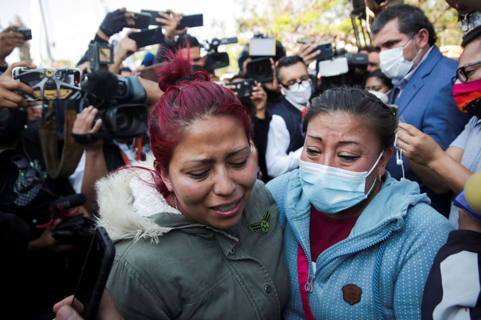 Relatives arrive looking for Brandon Giovani Hernandez Tapia, near the site where an overpass for a metro partially collapsed with train cars on it at Olivos station in Mexico City, Mexico May 4, 2021. Photo: Reuters