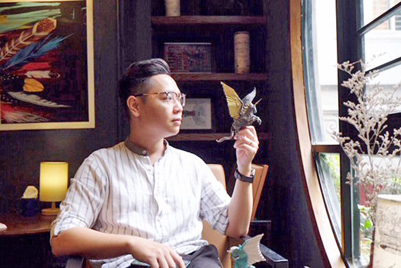 Young Vietnamese man infatuated with Origami