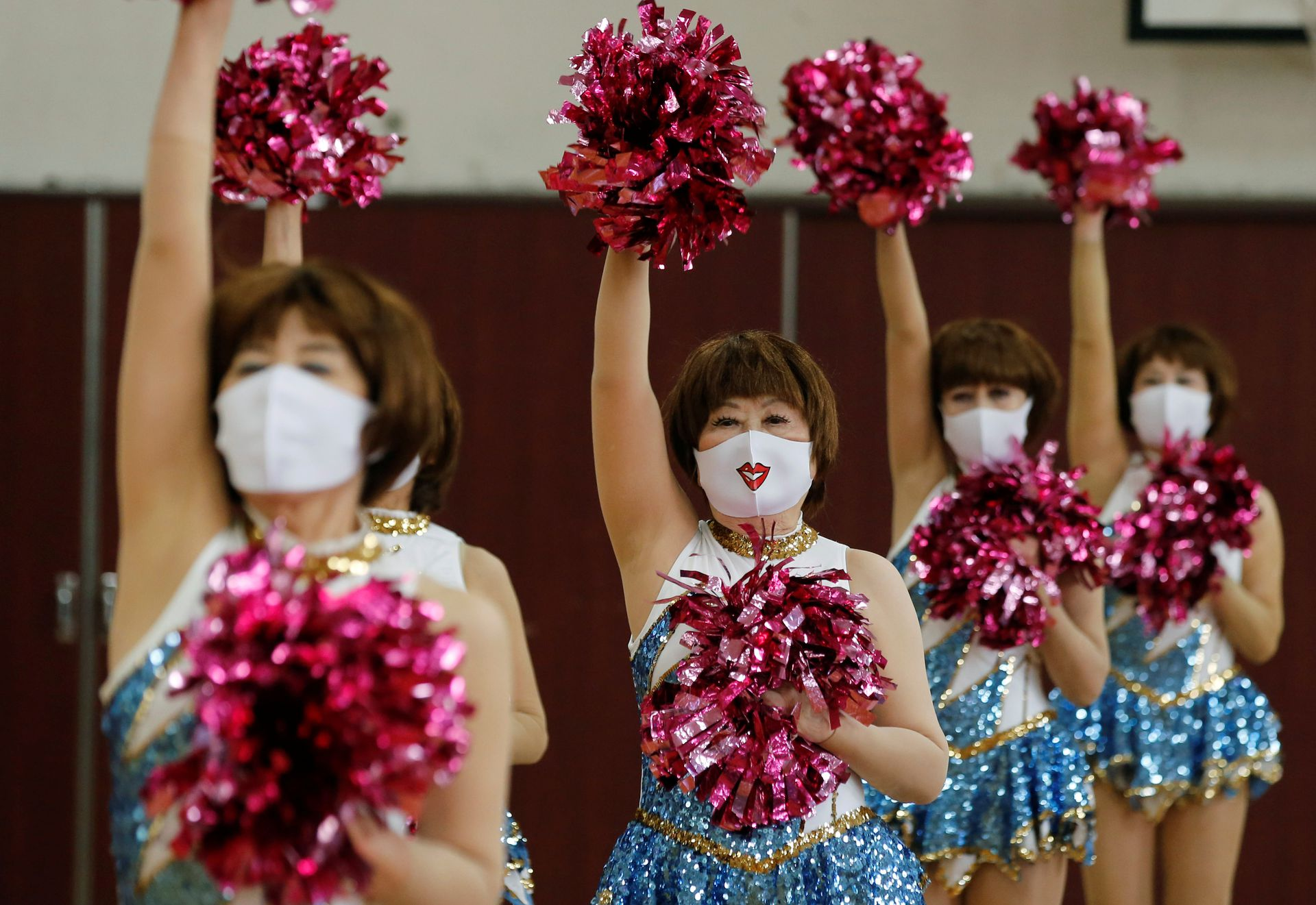 Fumie Takino, 89, founder of a senior cheer squad called Japan Pom Pom, and other Japan Pom Pom members, perform a dance routine while filming an online performance in Tokyo, Japan, April 12, 2021. Photo: Reuters