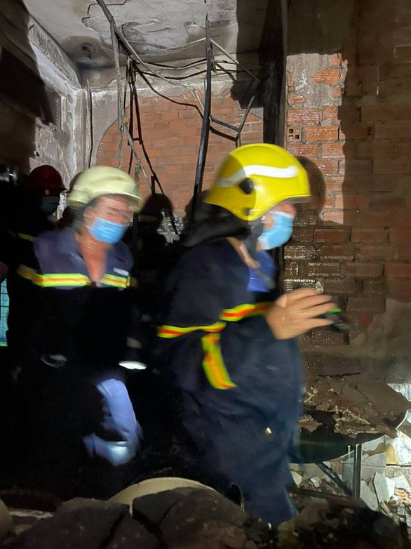 This supplied photo shows rescuers seeking victims at the fire scene.