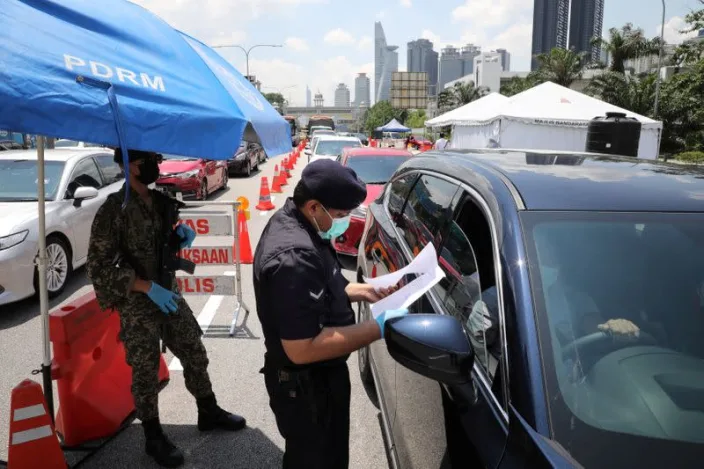 Malaysia declares nationwide lockdown as COVID-19 cases spike