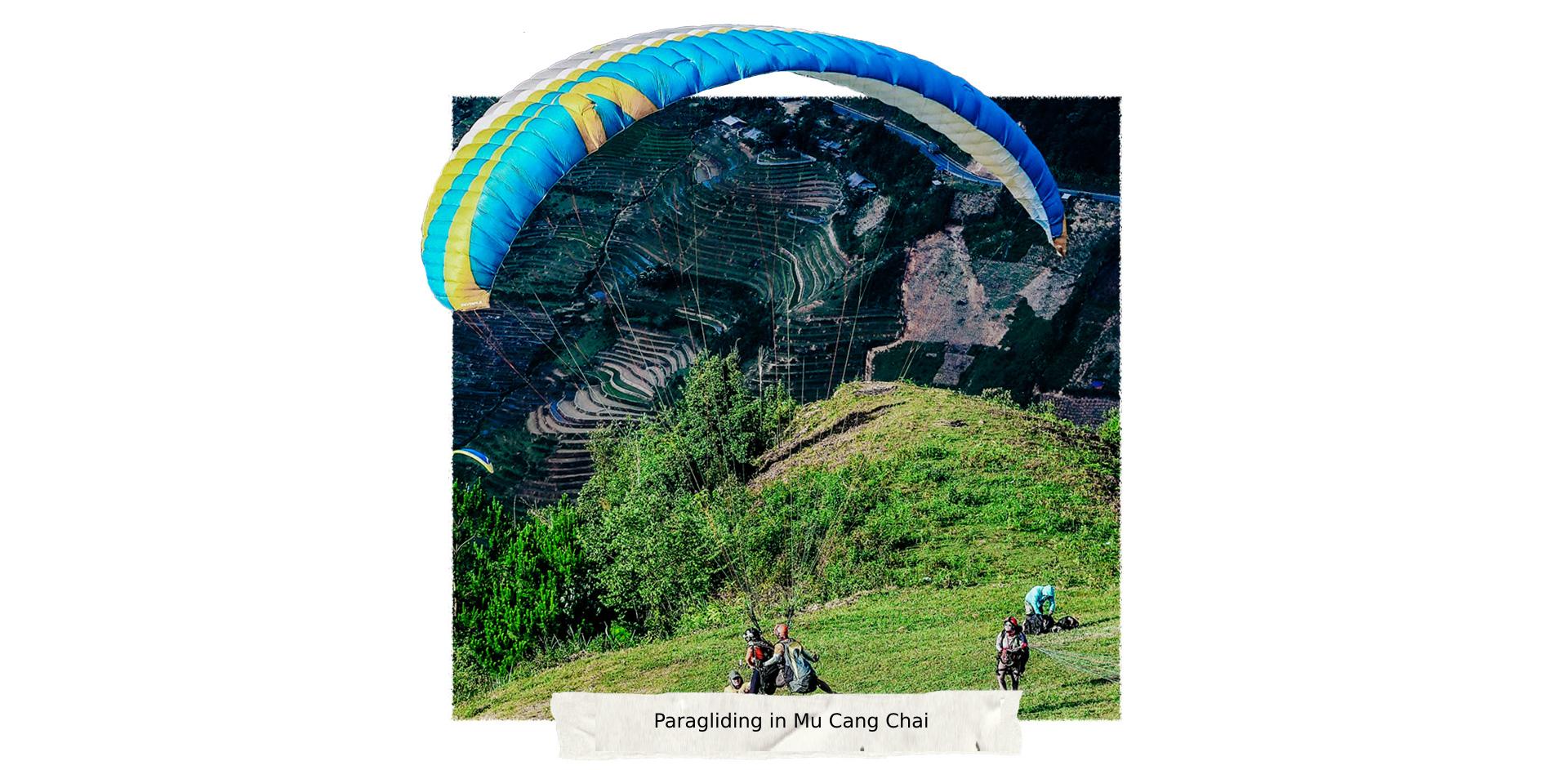 Tourists try paragliding in Mu Cang Chai District, Yen Bai Province, Vietnam. Photo: Nam Tran / Tuoi Tre