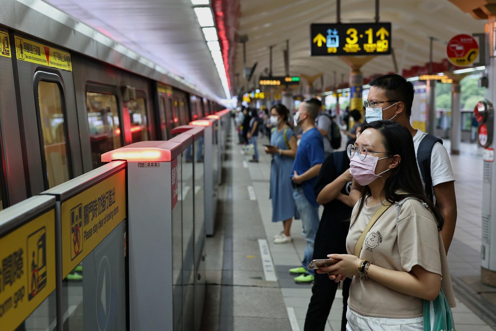 Taiwan warns on rising COVID-19 risk, stocks tank