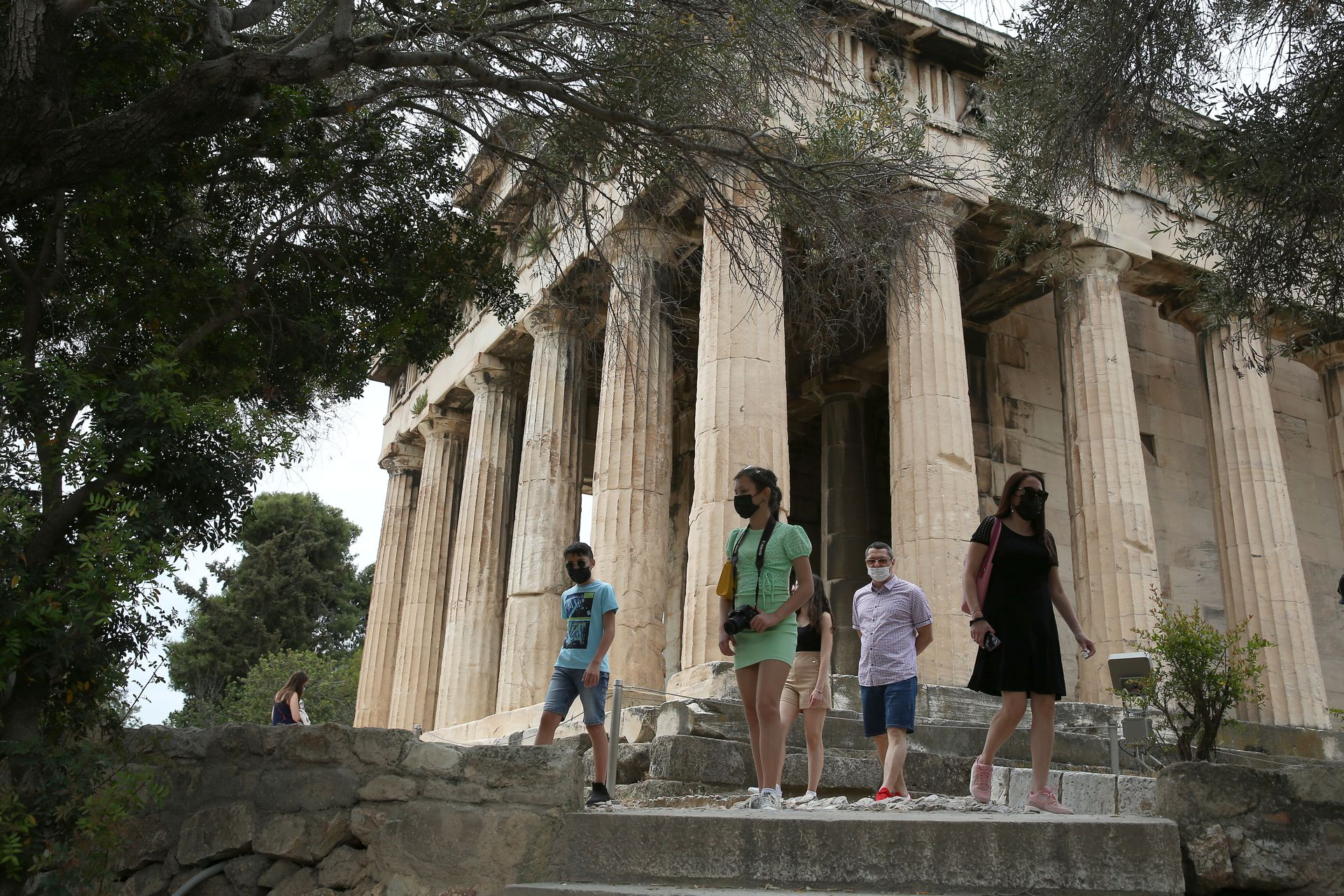 Tourists visit the ancient temple of Hephaestus, as the country's tourism season officially opens, in Athens, Greece May 15, 2021. Photo: Reuters