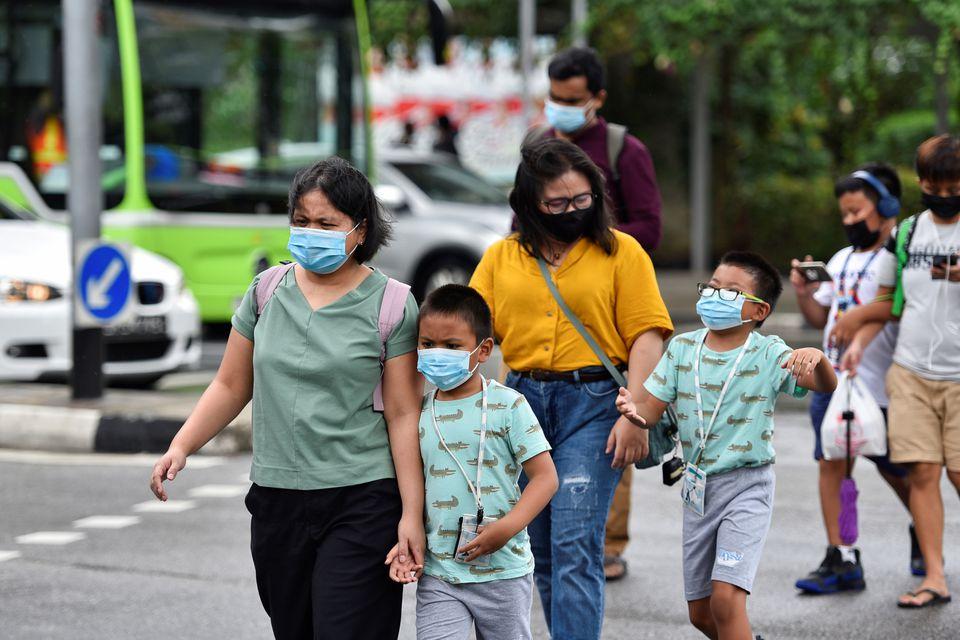 Singapore warns children susceptible to virus variants, shuts schools