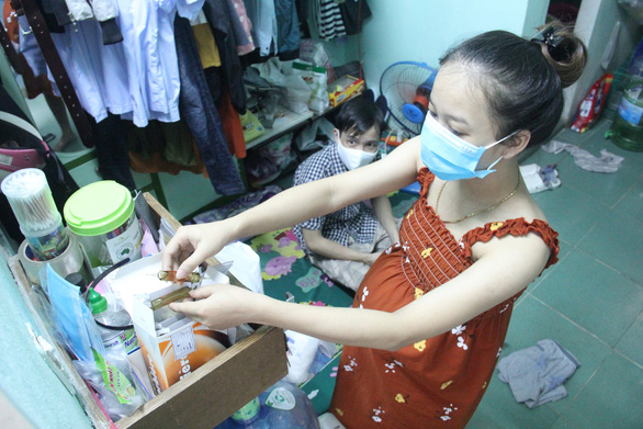 Nguyen Thi Ngoc Lan arranges a stack of medicine in preparation for the welcoming of her new child. Photo: Truong Trung/Tuoi Tre