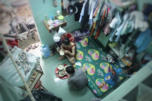 The couple has holed up in their tiny dorm room in order to protect themselves from COVID-19. Photo: Truong Trung/Tuoi Tre