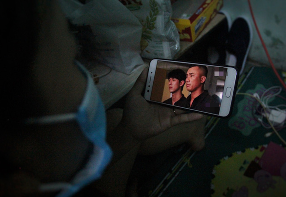 Korean dramas have become Nguyen Thi Ngoc Lan's only source of entertainment during the long hours she now spends at home. Photo: Truong Trung/Tuoi Tre