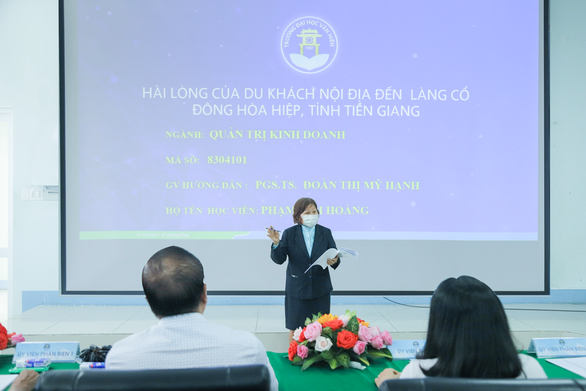 Pham Kim Hoang defends her MBA thesis at Van Hien University in Ho Chi Minh City. Photo courtesy of Van Hien University.