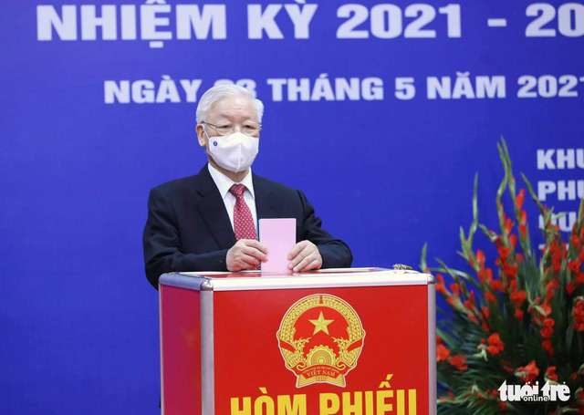 Vietnamese voters cast ballots to elect National Assembly deputies, local people's council members