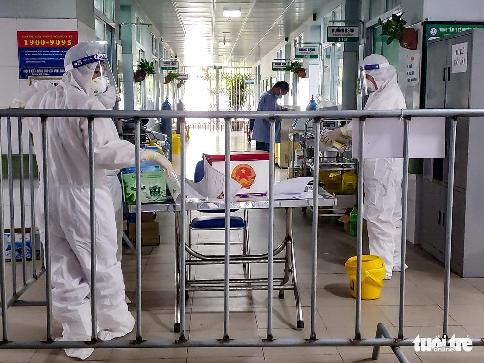 Medical officers prepare ballot box, ballots and other polling necessities at Makeshift Hospital No.1, Bac Ninh Province, VIetnam, May 22, 2021.