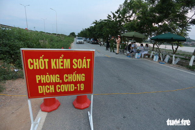 Northern Vietnamese city imposes curfew, sets up checkpoints as COVID-19 cases soar