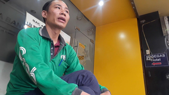 Nguyen Van Sang, a former tourist agency operation, now drives for Grab and runs an online business. Photo: Tam Le/Tuoi Tre