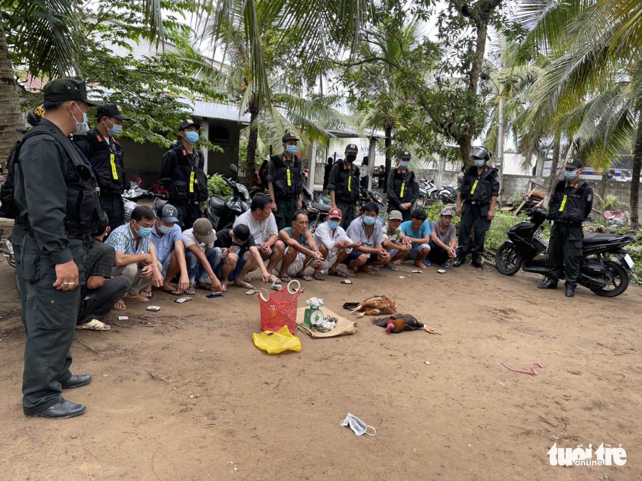 Illegal gamblers are caught betting on cockfight in Tien Giang Province, Vietnam, May 26, 2021. Photo: Hoai Thuong / Tuoi Tre