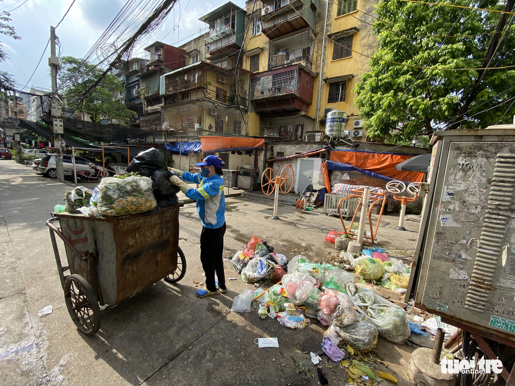Unpaid sanitation workers take out loans, collect scrap to survive in Hanoi