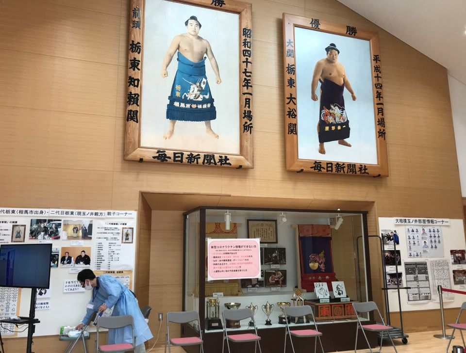 Portraits of sumo champions hang at the entrance of a gymnasium turned into a mass vaccination centre for the elderly in Soma, Fukushima Prefecture, Japan June 9, 2021. Photo: Reuters