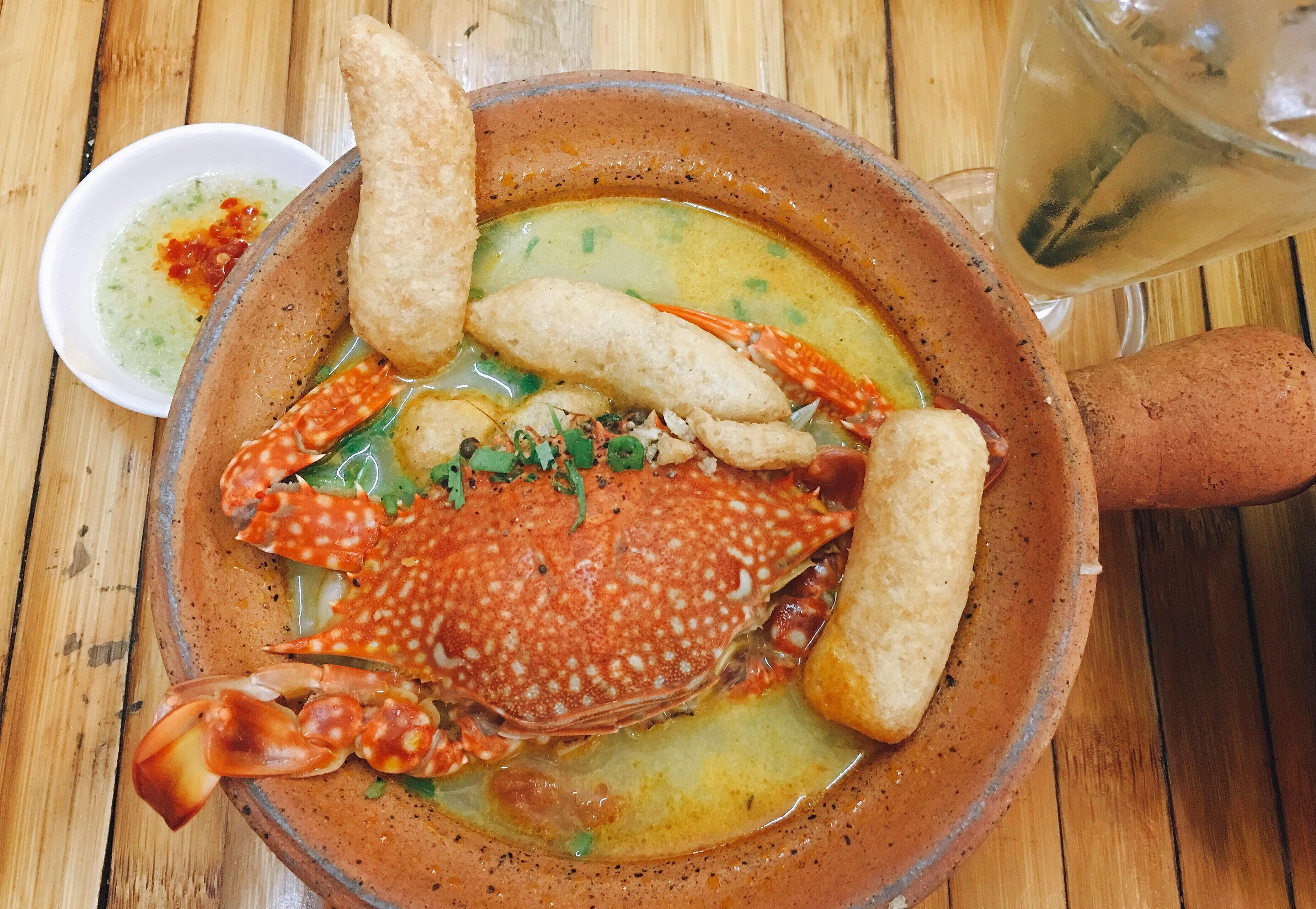 A bowl of banh canh topped with a whole flower crab is served in a restaurant in Ho Chi Minh City's District 10. Photo: Dong Nguyen / Tuoi Tre News