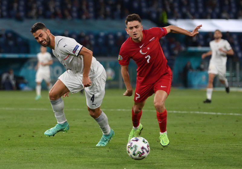 Soccer Football - Euro 2020 - Group A - Turkey v Italy - Stadio Olimpico, Rome, Italy - June 11, 2021 Turkey's Cengiz Under in action with Italy's Leonardo Spinazzola. Pool via Reuters