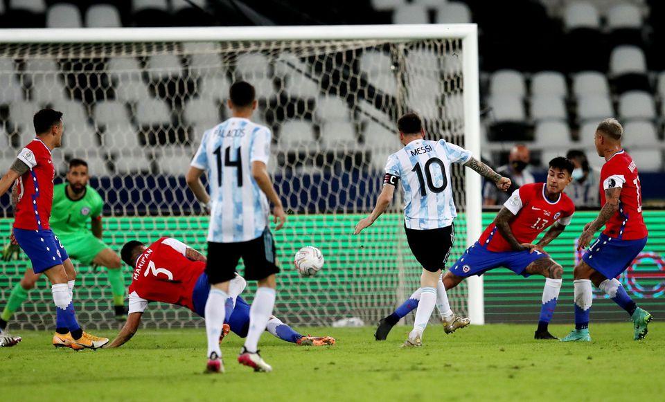 Soccer Football - Copa America 2021 - Group A - Argentina v Chile - Estadio Nilton Santos, Rio de Janeiro, Brazil - June 14, 2021 Argentina's Lionel Messi shoots at goal. Photo: Reuters