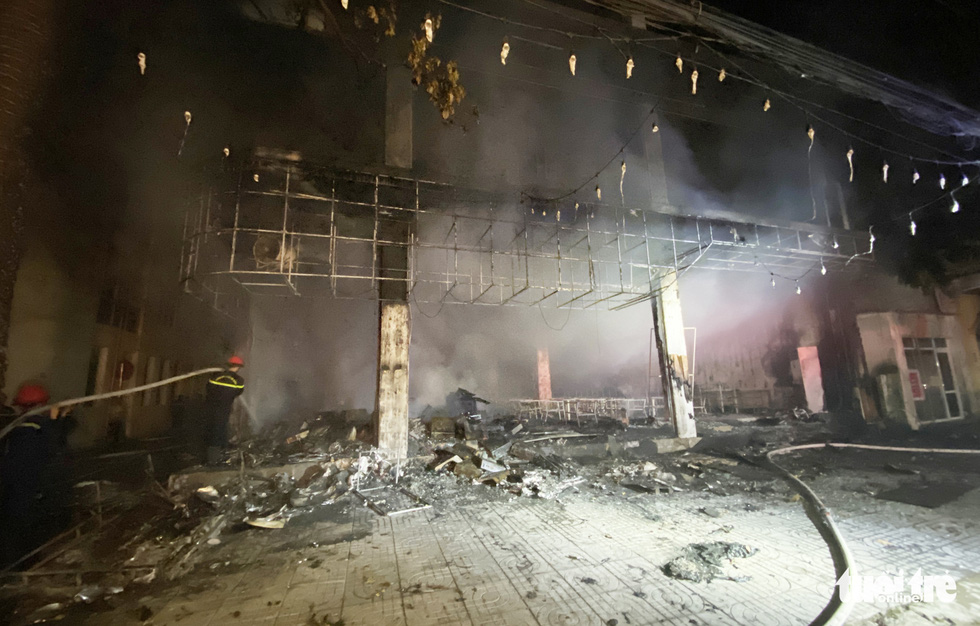 The devastating scene of the tea house is seen after the fire is put down on June 15, 2021. Photo: Doan Hoa / Tuoi Tre