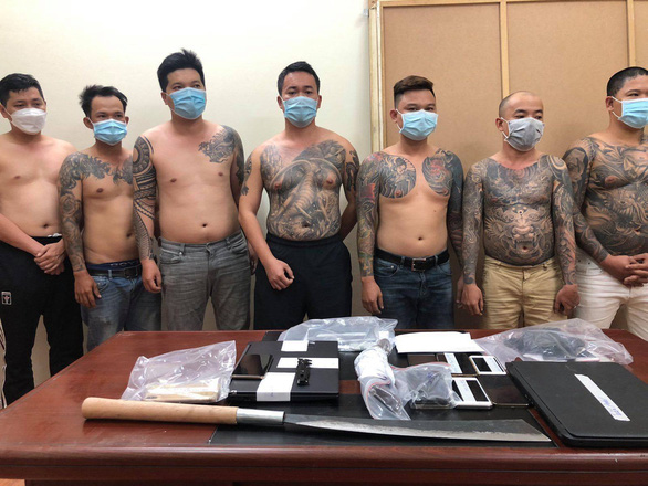 This supplied photo shows several members of the football betting gang busted by police on June 13, 2021.