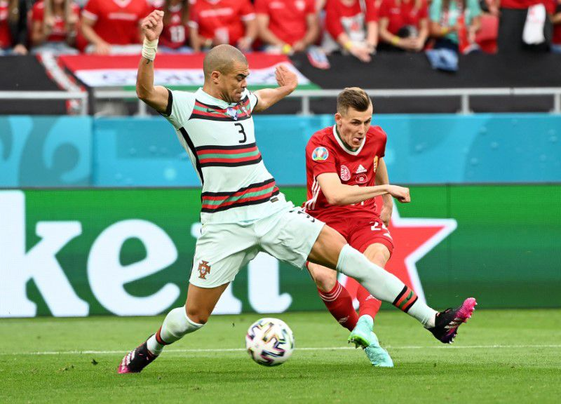 Soccer Football - Euro 2020 - Group F - Hungary v Portugal - Puskas Arena, Budapest, Hungary - June 15, 2021 Hungary's Szabolcs Schon scores their first goal which is later disallowed for offside. Pool via Reuters