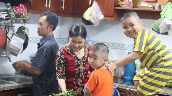 Le Thi Kieu Ngan, a devoted wife, enjoys happy moments with her current husband and their two young sons at their tenanted house in Thu Duc City, Ho Chi Minh City, Vietnam when she is not behind the wheel. Photo: Le Van/ Tuoi Tre