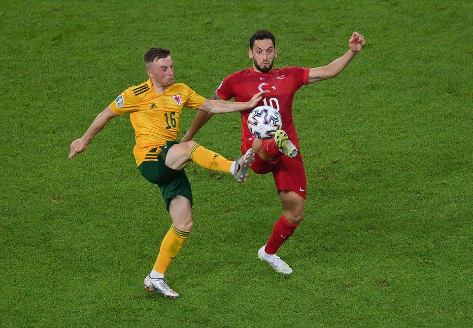 Soccer Football - Euro 2020 - Group A - Turkey v Wales - Baku Olympic Stadium, Baku, Azerbaijan - June 16, 2021 Wales' Joe Morrell in action with Turkey's Hakan Calhanoglu. Pool via Reuters