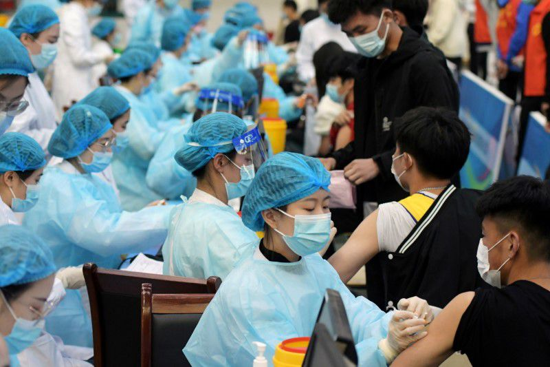 China reports 23 new COVID-19 cases versus 19 the day before