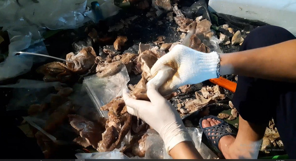 In this supplied photo, drugs were found hidden in pig abdomens at a factory in Hanoi.