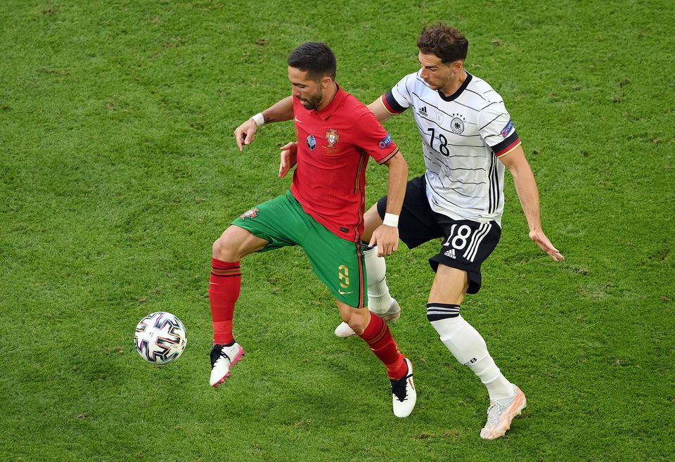 Soccer Football - Euro 2020 - Group F - Portugal v Germany - Football Arena Munich, Munich, Germany - June 19, 2021 Portugal's Joao Moutinho in action with Germany's Leon Goretzka. Photo: Pool via Reuters