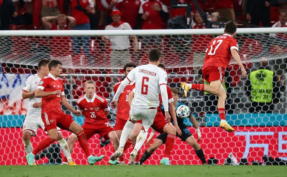 Soccer Football - Euro 2020 - Group B - Russia v Denmark - Parken Stadium, Copenhagen, Denmark - June 21, 2021 Denmark's Andreas Christensen scores their third goal. Pool via Reuters
