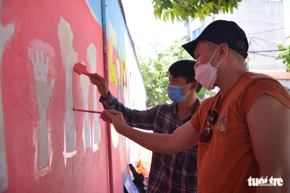 A team of three to four artists can complete a mural of 20 square meters in two to three days. Photo: Ha Quan/Tuoi Tre