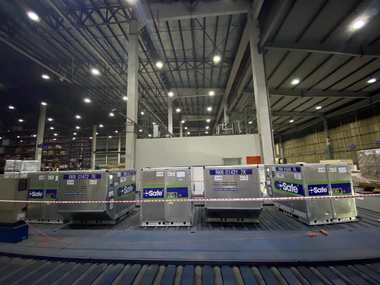 Containers of AstraZeneca vaccine shots  donated by Japan are temporarily kept at Tan Son Nhat Cargo Services Joint Stock Company in Ho Chi Minh City, July 2, 2021. Photo: C.Trinh / Tuoi Tre