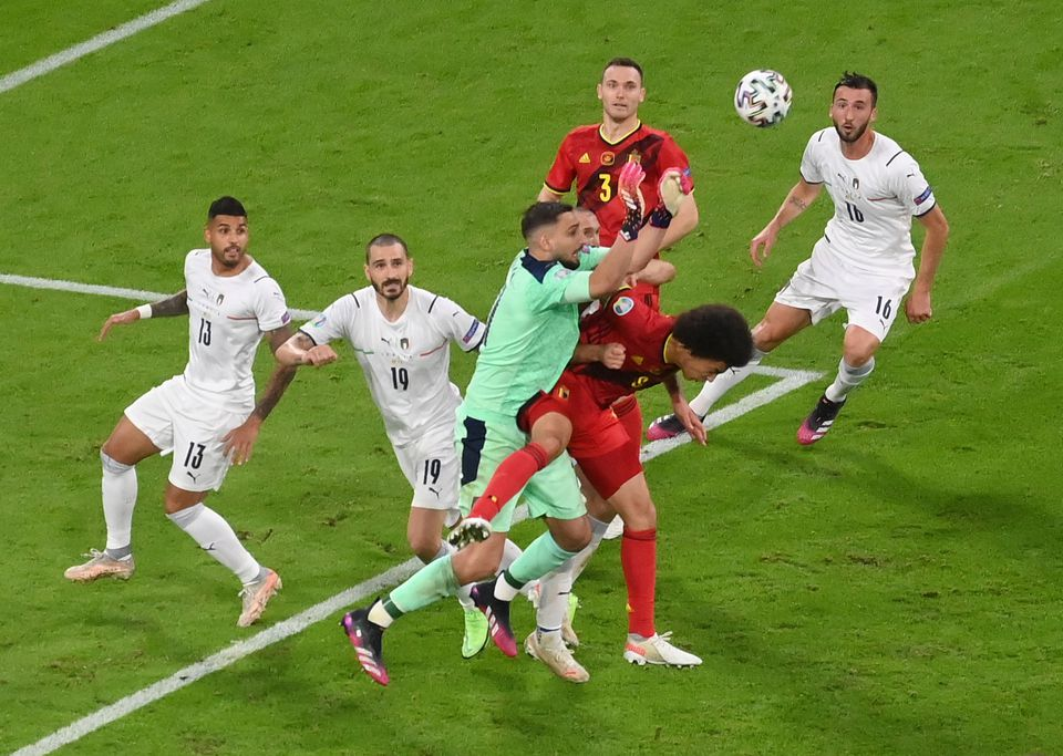 Soccer Football - Euro 2020 - Quarter Final - Belgium v Italy - Football Arena Munich, Munich, Germany - July 2, 2021 Italy's Gianluigi Donnarumma in action with Belgium's Axel Witsel. Pool via Reuters