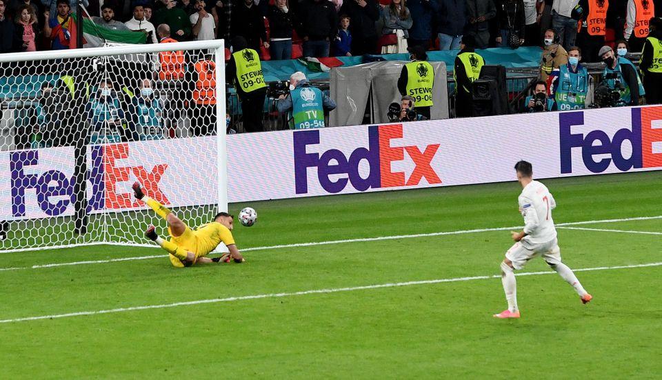 Soccer Football - Euro 2020 - Semi Final - Italy v Spain - Wembley Stadium, London, Britain - July 6, 2021 Italy's Gianluigi Donnarumma saves a penalty from Spain's Alvaro Morata during a penalty shootout. Photo: Pool via Reuters